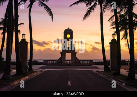 Worth Avenue Clock Tower at sunrise on South Ocean Boulevard at Worth Avenue in Palm Beach, Florida. (USA) - Stock Photo