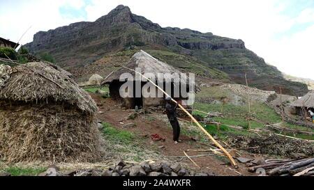 Western Ethiopian Highlands/Ethiopia - April 20, 2019: Ethiopian farmer works outside his hut in the Simian Mountains - Stock Photo
