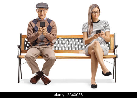 Full length shot of a senior man and a young lady sitting on a bench with smartphones isolated on white background - Stock Photo