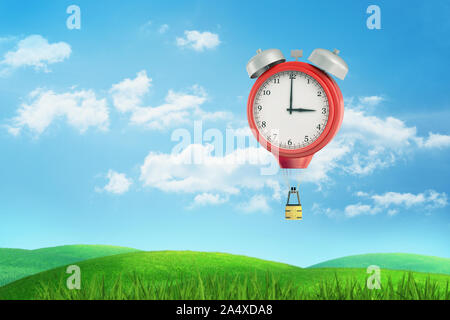 3d rendering of a giant red vintage clock flying above a green meadow like a hot air balloon with a basket. - Stock Photo