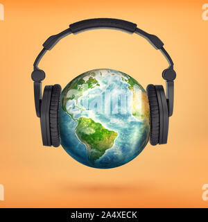 3d rendering of large black headphones placed on an Earth globe pretending it's a head. - Stock Photo