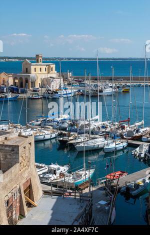 View across harbour from Gallipoli Castle with Chiesa di Santa Maria del Canneto in background – Gallipoli, Apulia (Puglia) in Southern Italy - Stock Photo