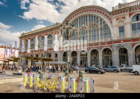 Hire bicycles outside the front the front entrance of Torino Porta Nuova railway station ,Turin's main and busiest  railway station ,Turin ,Italy - Stock Photo
