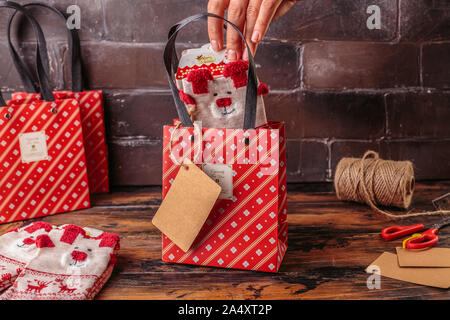 Gift boxes wrapped in red checked paper. Valentines day, Christmas, New year gift packing. Holiday decor concept.