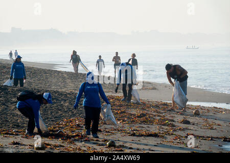 4ocean volunteers collecting plastic trash and other rubbish off Canggu beach in Bali, Indonesia - Stock Photo