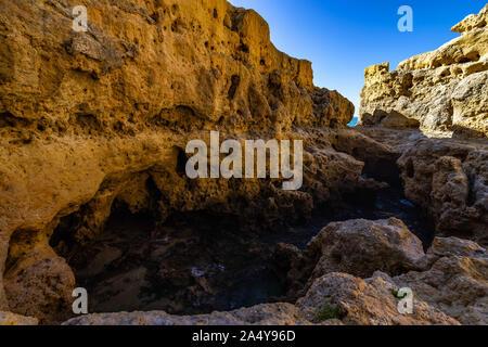 Cliffs and spectacular rock formations at Algar Seco, Carvoeiro, Algarve, Portugal - Stock Photo