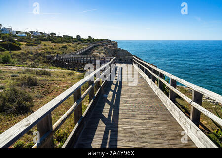 Carvoeiro boardwalk is a scenic cliff top walk that leads from the town to the Algar Seco rock formation, Algarve, Portugal - Stock Photo