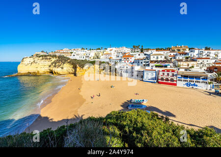 View of Carvoerio, a popular holiday destination in Algarve. From Carvoeiro departing boat tours to visit the famous Benagil cave. Carvoeiro, Portugal - Stock Photo