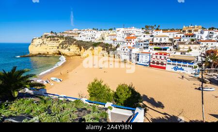 View of Carvoerio beach, a popular holiday destination in Algarve region. Carvoeiro, Portugal, April 2019 - Stock Photo