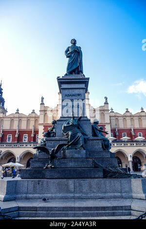 The statue of Adam Mickiewicz, the greatest Polish Romantic poet of the 19th century locted at Rynek Glowny Main Square of Krakow Old Town, Poland - Stock Photo