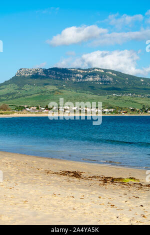 a view of one of the mountain peaks and beach seen from Bolonia beach in Cadiz, spain - Stock Photo