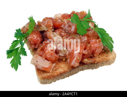 A sandwich for a tough guy. On bread a thick layer of salmon tartare and a small leaf of parsley. Isolated on white studio macro - Stock Photo
