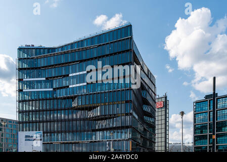 Berlin, Germany - July 27, 2019: Cube Berlin, a modern glass office building located on Washingtonplatz, besides central station and Spreebogen, on th - Stock Photo