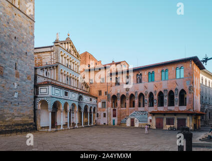 Pistoia, Tuscany, Italy main square Piazza Duomo with beautiful cathedral front and old gothic bishops palace under clear blue sky