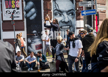 Crowds near Jack Nicholson artwork on May Day 2019 in Berlin, Germany - Stock Photo