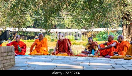 Senior Buddhist monks sitting infront of Maya Devi Temple at Lumbini, Nepal - Stock Photo