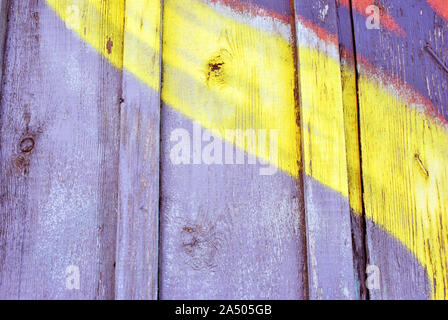 Gray painted wooden planks surface close up detail with yellow line, grunge horizontal shabby background