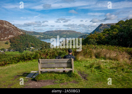 Man looking towards Ullswater and Gowbarrow Fell from Birkhouse Moor Lake District National Park Cumbria England UK United Kingdom GB Great Britain - Stock Photo