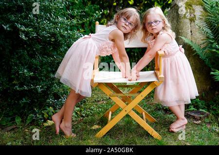 6 years old, 3 years old, Two Girls Siblings, Portrait, Karlovy Vary, Czech Republic - Stock Photo