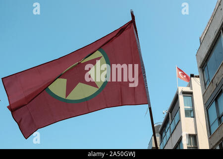 Tel Aviv, Israel. 17th October, 2019. Protesters carry Kurdish Labor Party flags and signs in support of Kurds and condemning Turkey's offensive in northeastern Syria as they demonstrate outside the Turkish Embassy in Israel. Credit: Nir Alon/Alamy Live News. - Stock Photo