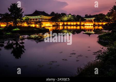 Anapji or Wolji pond scenic view and illuminated Donggung palace at twilight sunset with beautiful sky in Gyeongju South Korea - Stock Photo