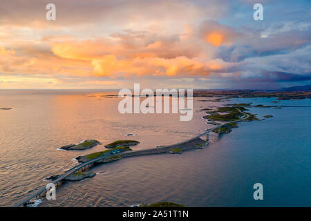 Sunset over the Atlantic Road, aerial view, More og Romsdal county, Norway - Stock Photo