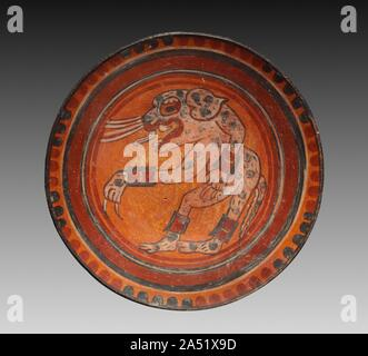 Plate, c. 800. Flamboyant painted images characterize pottery of the Late Classic period (AD 250-900) from the Yucatan Peninsula. Its pose and jewelry indicate that this dancing figure is a human being in a jaguar costume. - Stock Photo