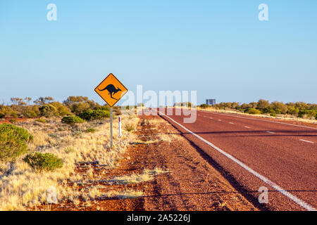 Kangaroo road sign on remote outback road Stuart Highway connecting Port Augusta, South Australia with Alice Springs, Northern Territory, Australia - Stock Photo