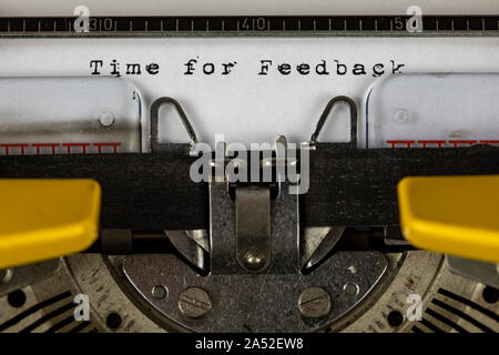 old typewriter with text time for feedback - Stock Photo