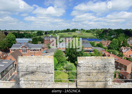 Part of Marlborough College, and sports field, seen from the tower of St Peter's church. - Stock Photo
