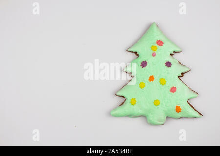 Christmas homemade gingerbread cookies on a white background. Sweet colored gingerbread cookies, place for text. Christmas tree. Copyspace - Stock Photo