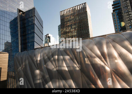 The Vessel structure and The Shed, a cultural venue, are in  the Hudson Yards Complex, New York City, USA - Stock Photo
