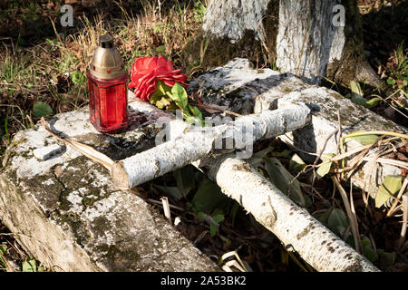 Old wooden cross on grave in cemetery in Lupkow. Bieszczady, Eastern Carpathian, Poland. - Stock Photo
