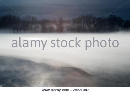 Gloomy weather and fog cover the Hudson River near Troy, NY. - Stock Photo