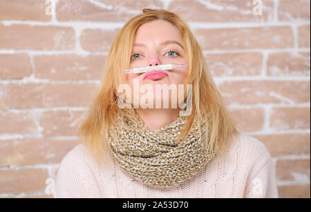 Fever symptoms and causes. Sick girl with fever. Girl hold thermometer and tissue. Measure temperature. Break fever remedies. High temperature concept. How to bring fever down. Woman feels badly ill. - Stock Photo