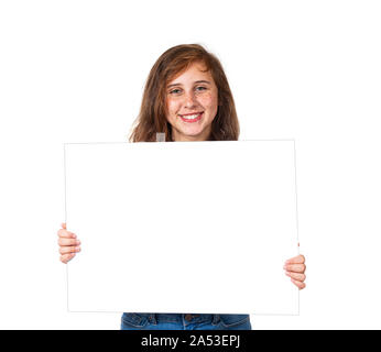 Horizontal studio shot of a smiling pre-teen girl with freckles holding a blank white sign.  Isolated on white.