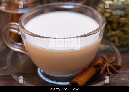 Closeup image of traditional indian masala chai tea with spices - Stock Photo