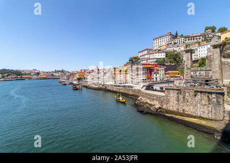 Porto, Portugal old town skyline from across the Douro River - Stock Photo