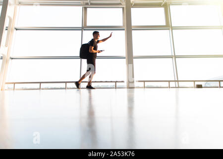businessman rushing in airport to catch a flight - Stock Photo