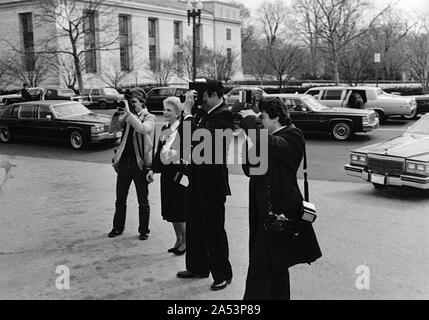 Washington DC, USA, February 19, 1984 Princess Grace Foundation luncheon at the United States State Department, paparazzis including Ron Galella (2nd from right) line up to photograph the celebs - Stock Photo