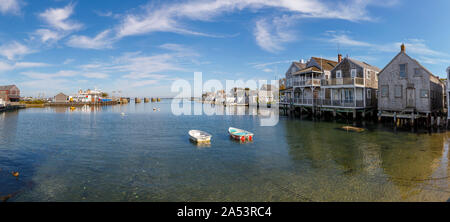 Tranquil harbour view of waterfront houses in Nantucket, Nantucket Island, Cape Cod, Massachusetts, New England, USA on a sunny day with blue sky - Stock Photo