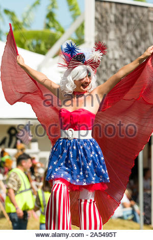 Woman participating in the 54th annual Makawao Rodeo Parade dressed in a red, white and blue patriotic costume, Makawao, Maui, Hawaii, USA - Stock Photo