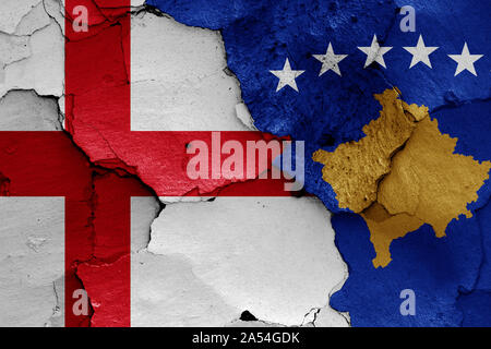 flags of England and Kosovo painted on cracked wall - Stock Photo