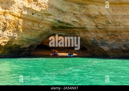 Entering the Algar de Benagil (Benagil cave), the most famous tourist attraction in Algarve, Portugal - Stock Photo