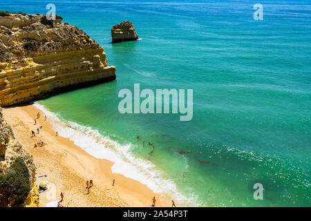 Aerial view of Praia da Marinha (Marinha Beach) with soft sands lapped by turquoise sea waters, Algarve, Portugal - Stock Photo