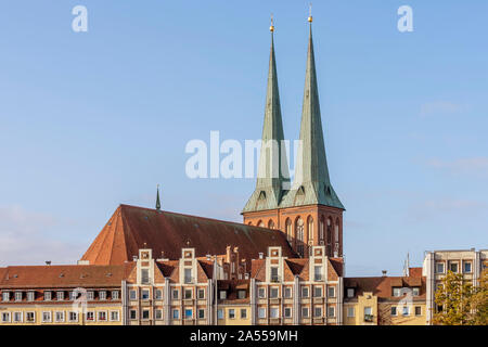 The spiers of St. Nicholas Church illuminated by morning light in the Mitte district of Berlin, Germany - Stock Photo