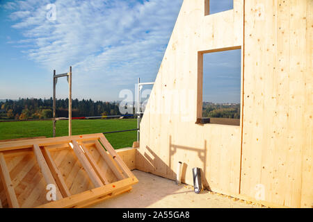 Construction of a wooden house, which are a more ecological and economic alternative than homes made of traditional brick and concrete - Stock Photo