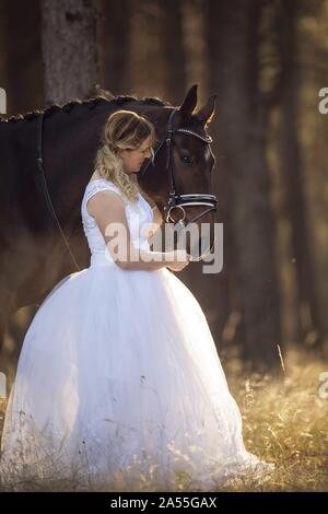 woman with english thoroughbred - Stock Photo