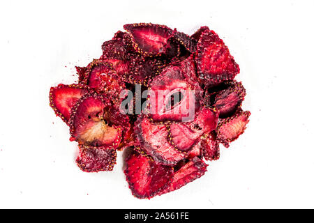 Heap of sun dried sweet strawberries isolated on white background. Top view - Stock Photo