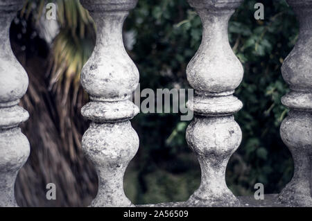 Balusters made of stone on the old historic staircase - Stock Photo